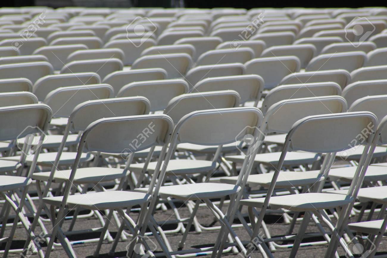 Black folding chairs wedding - Black Folding Chairs Wedding Rows Of White Empty Folding Chairs At A Concert Wedding Festival