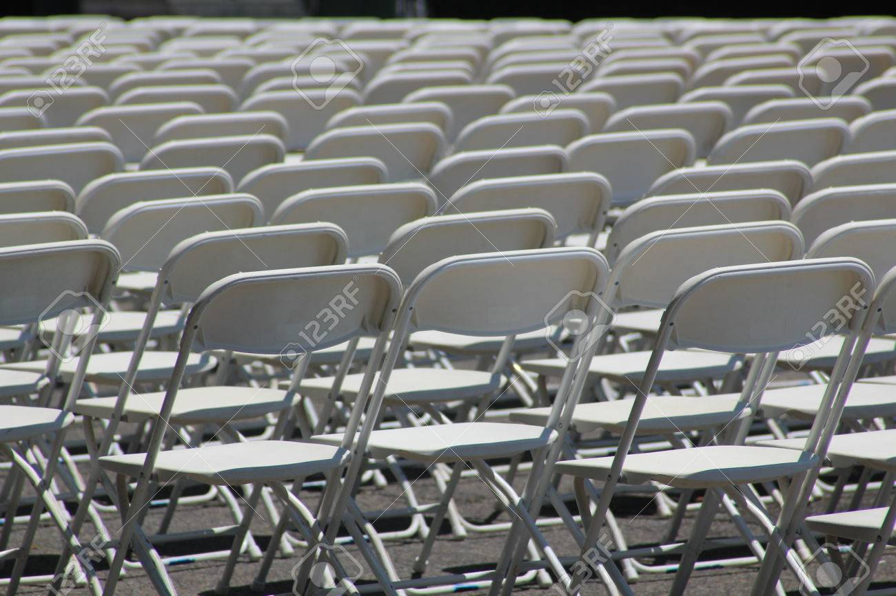 Rows of white empty folding chairs at a concert wedding festival or ceremony Stock & Rows Of White Empty Folding Chairs At A Concert Wedding Festival ...