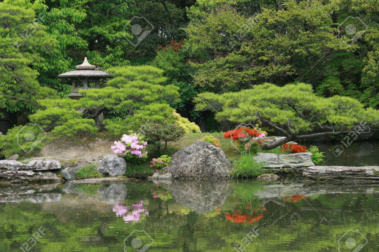 Beautiful Japanese Garden With Pond And Stone Ornaments Stock - Japanese garden ornaments