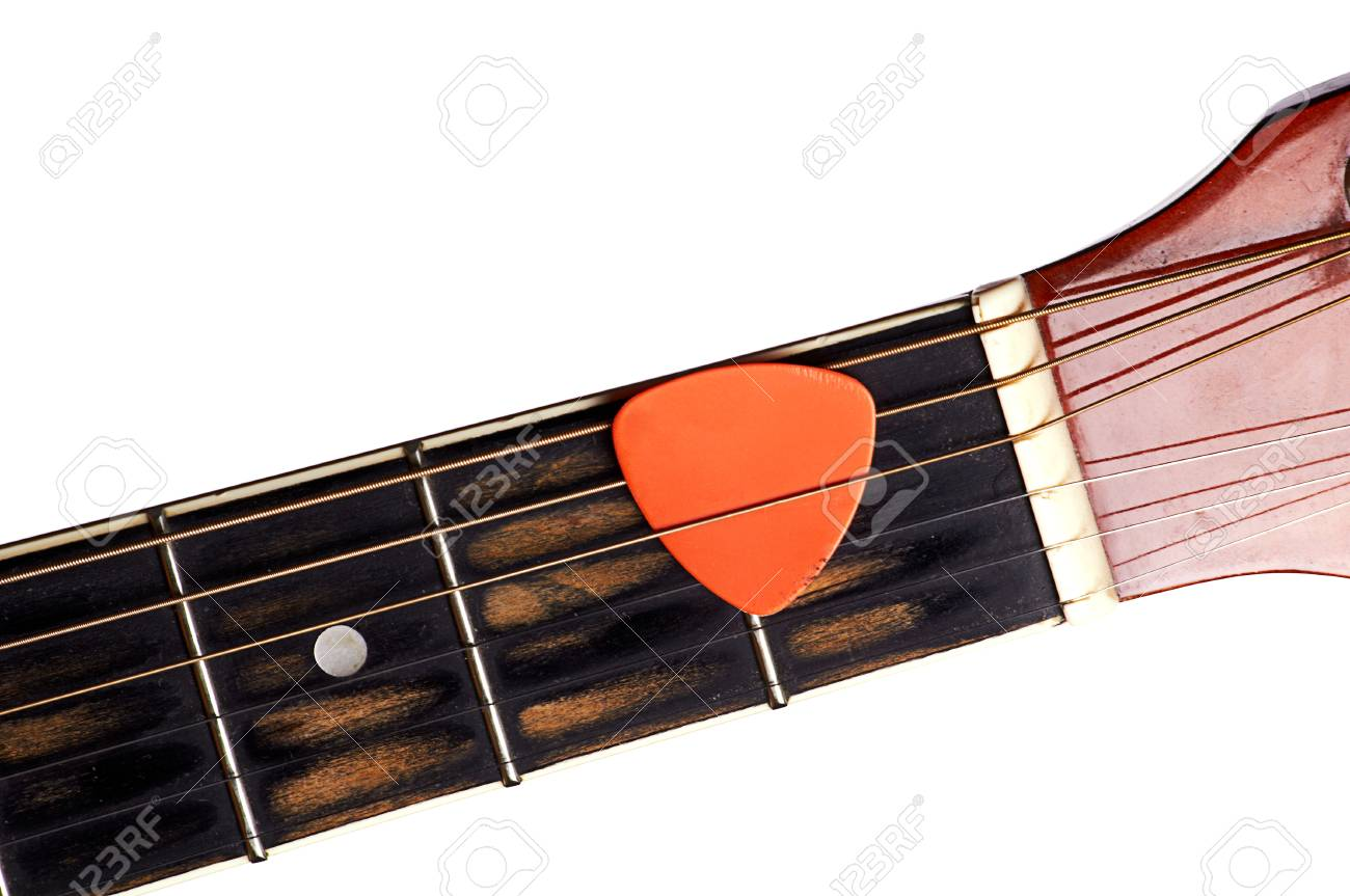 Orange guitar pick on the fingerboard Stock Photo - 22345231