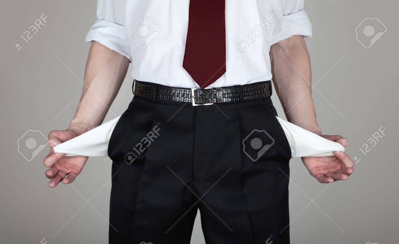 The businessman in a white shirt and black trousers shows his empty pockets Stock Photo - 13268833