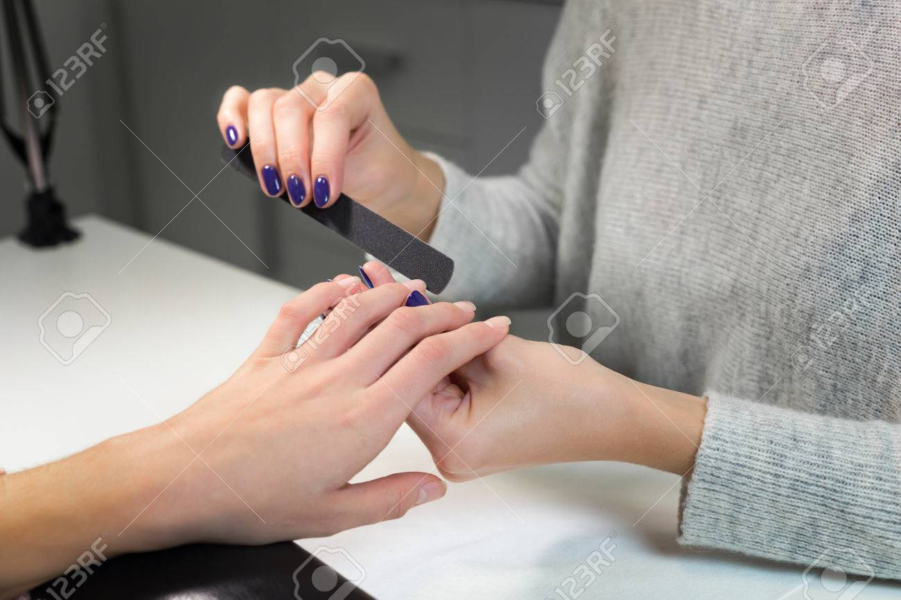 Professional Process Of Manicure By Nail File In White Beauty ...