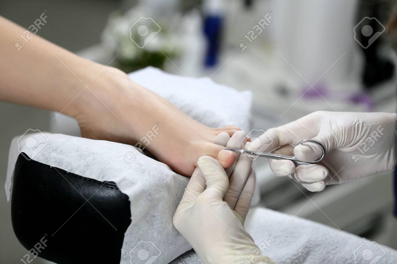 Cutting Cuticle On Foot, Nail Scissors. Pedicure Stock Photo ...