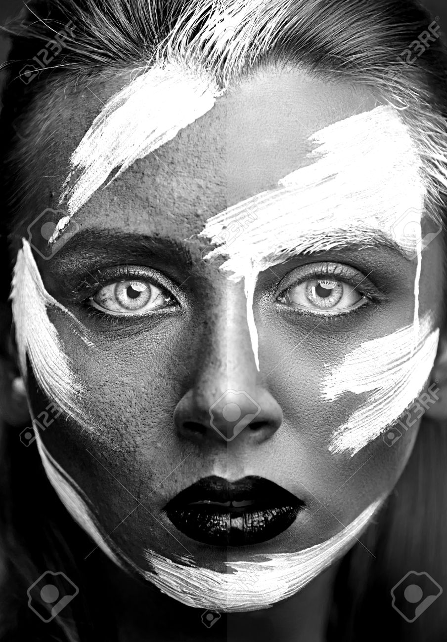 Process of photo retouching black and white portrait of girl with art make up half of the girl face without professional retouching and processing and half