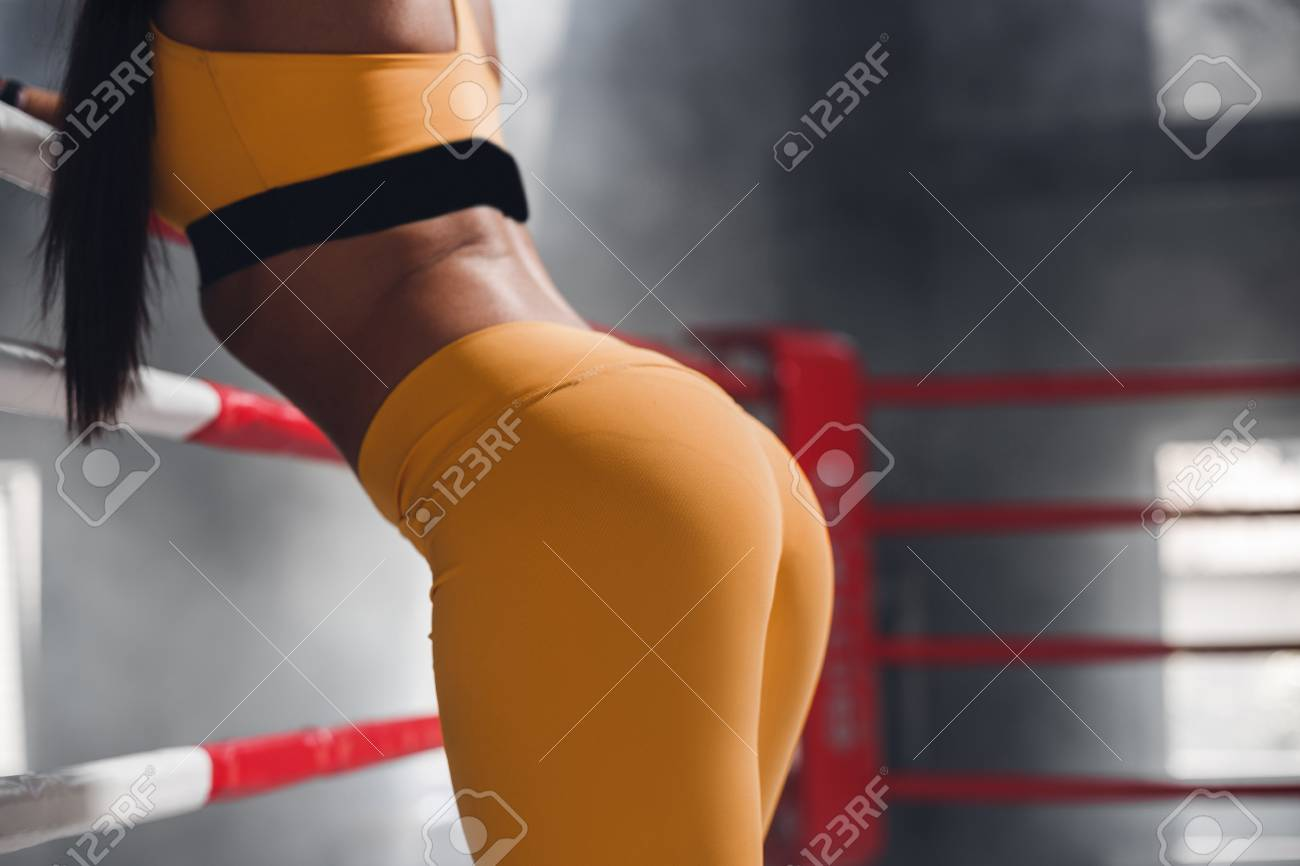sexy beautiful athletic ass, female in boxing ring leaning on