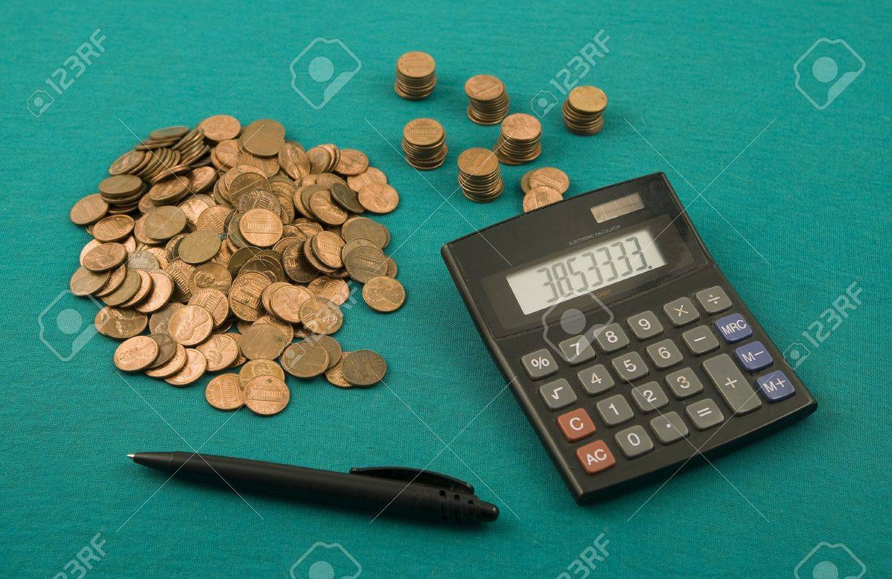 Cents And The Calculator On A Table The Beginning Of New One Million Stock P O
