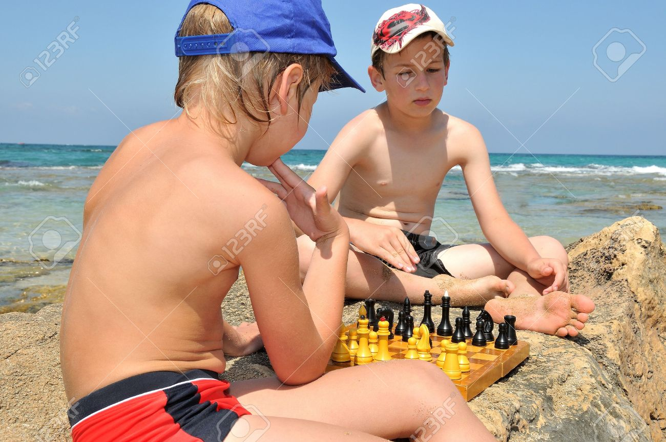 Boys On Vacation Playing Chess...