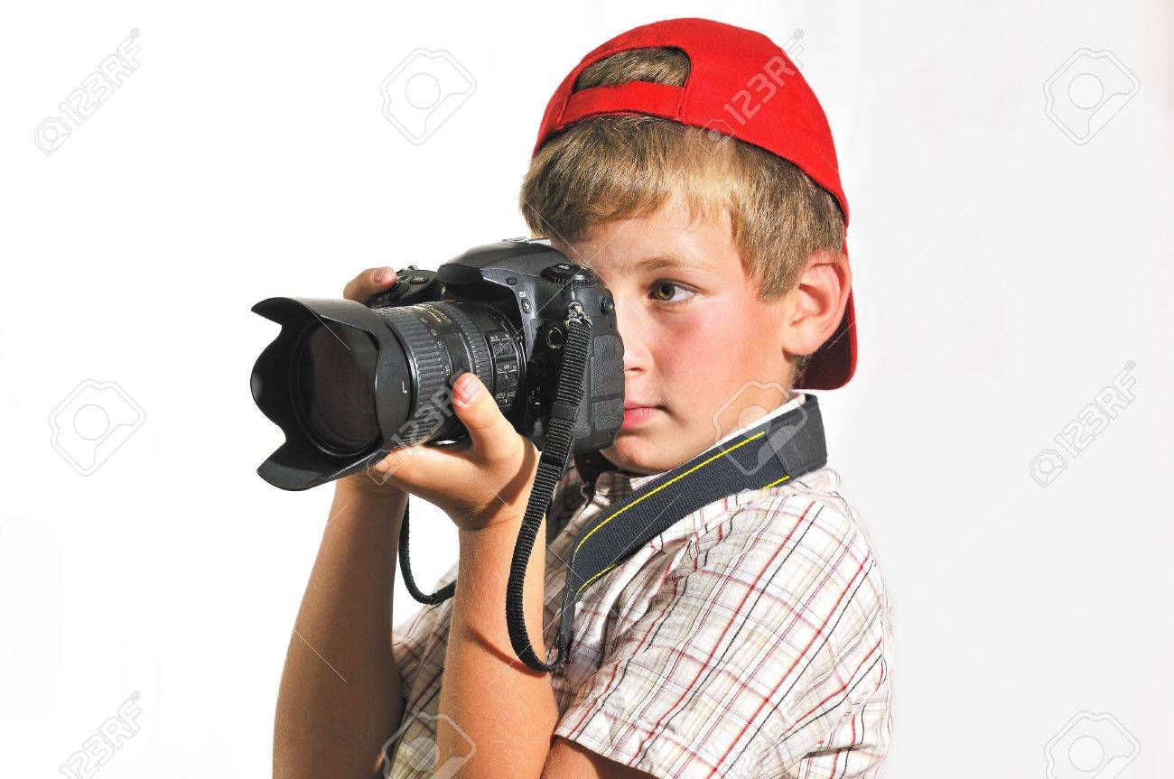 boy holding a camera and someone photographs stock photo picture