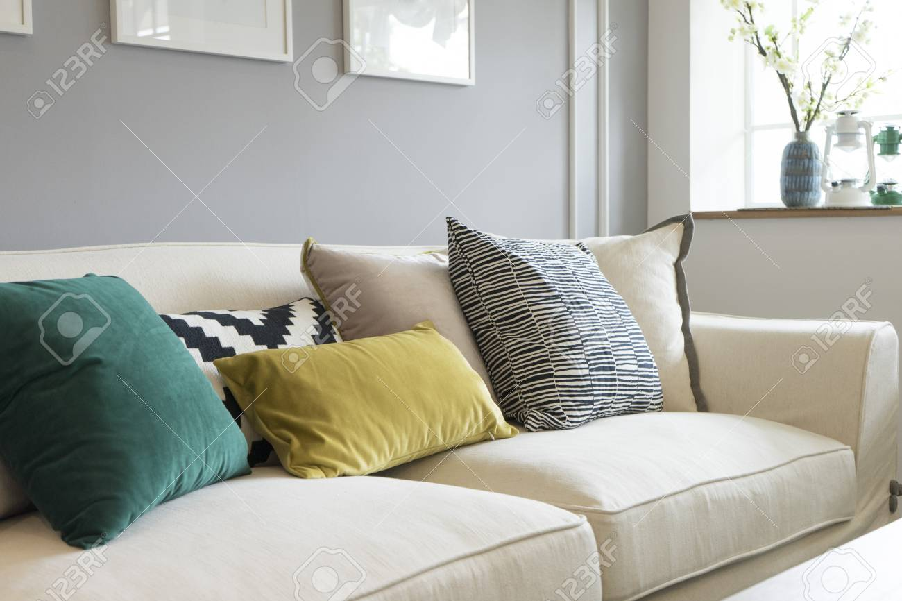 Close up of colorful pillows on sofa in modern living room