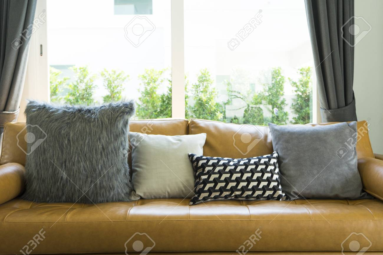 Modern Decorative Pillow On Brown Leather Sofa In Living Room Stock Photo Picture And Royalty Free Image Image 100513621