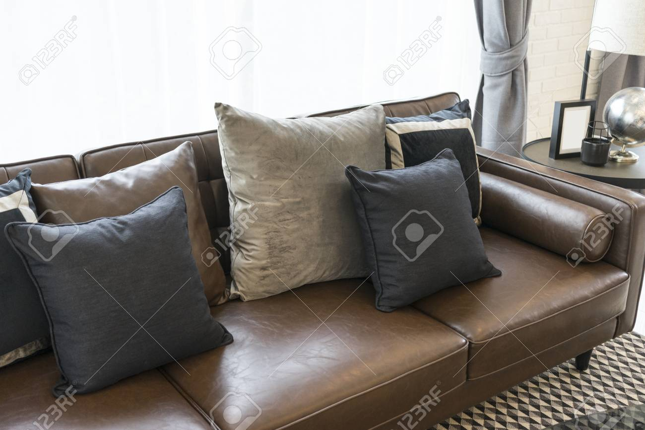 luxury black and grey pillow on dark brown sofa in living room..