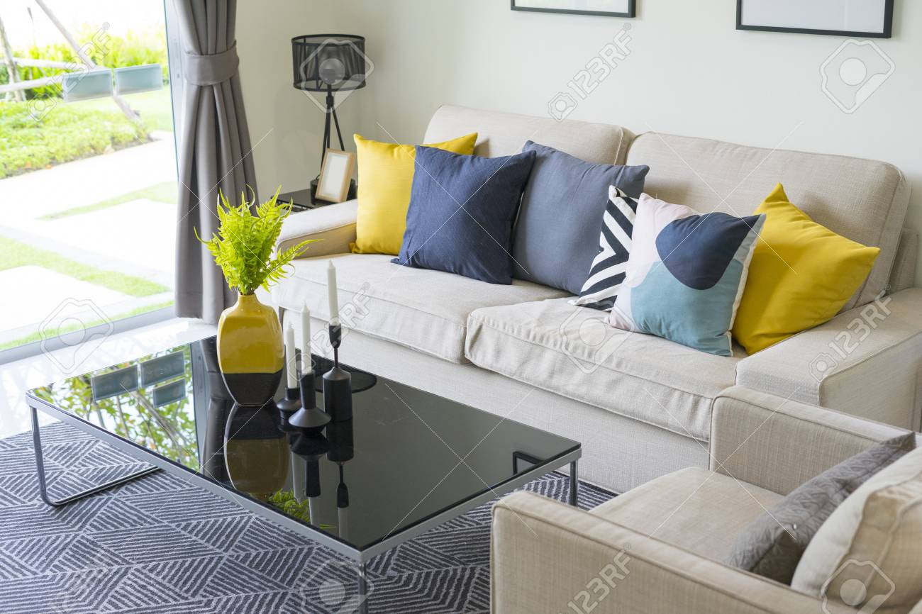 Modern Pattern Blue And Yellow Cushion On Grey Sofa In Living