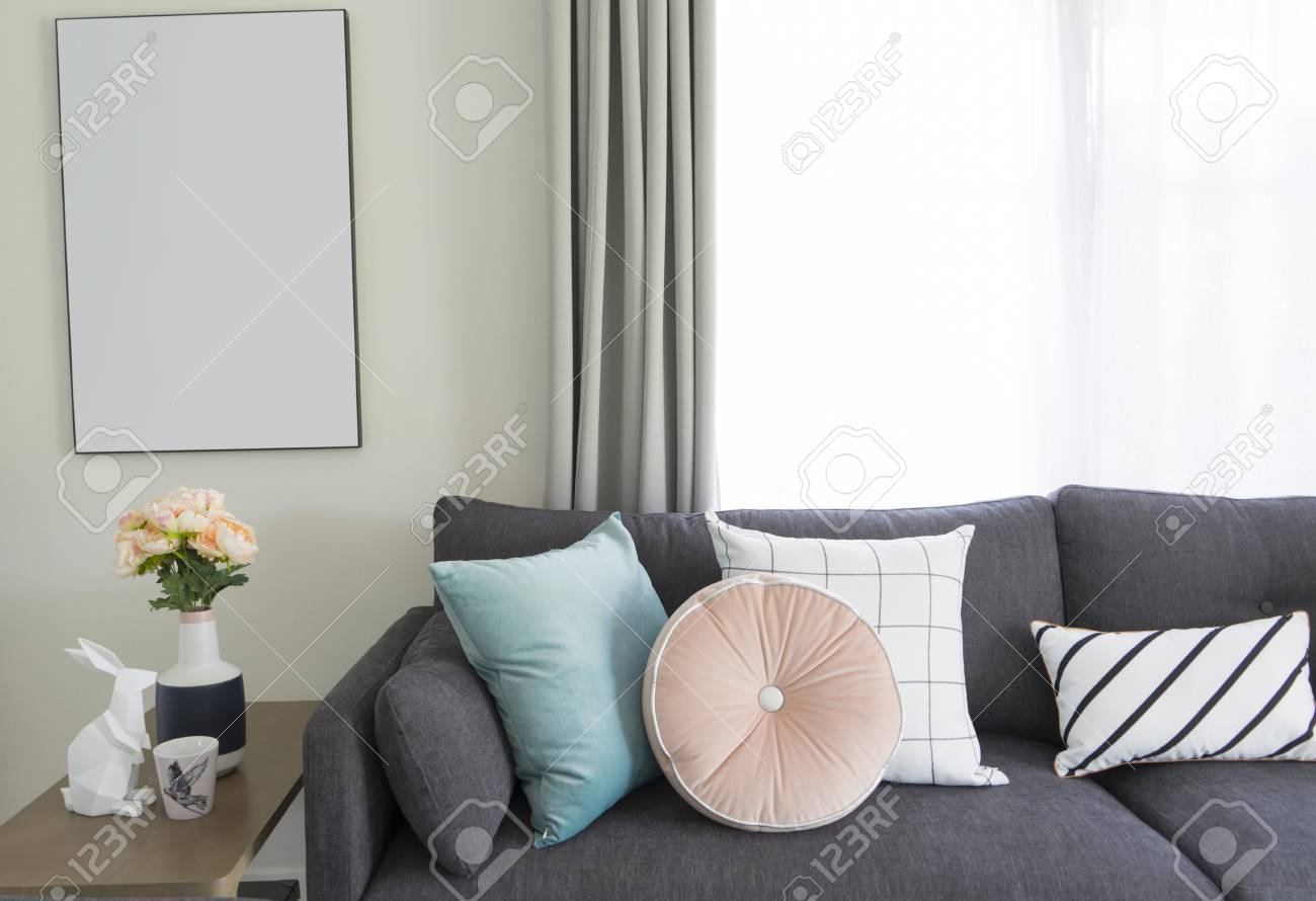 Pink And Blue Cushion On Grey Sofa In Living Room