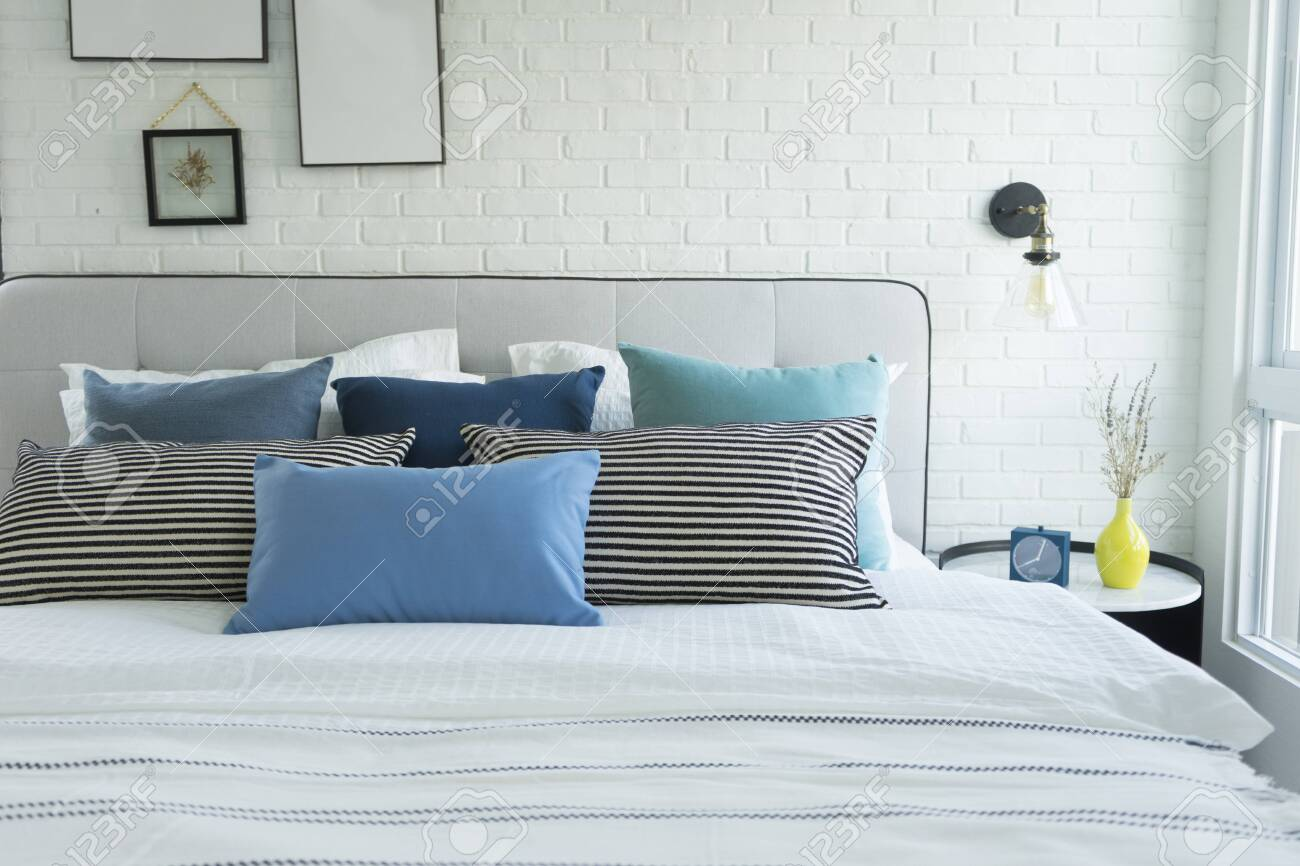 White and blue spacious bedroom with a large bed, in the Scandinavian style. Mockup and free space for text and pictures - 136102604