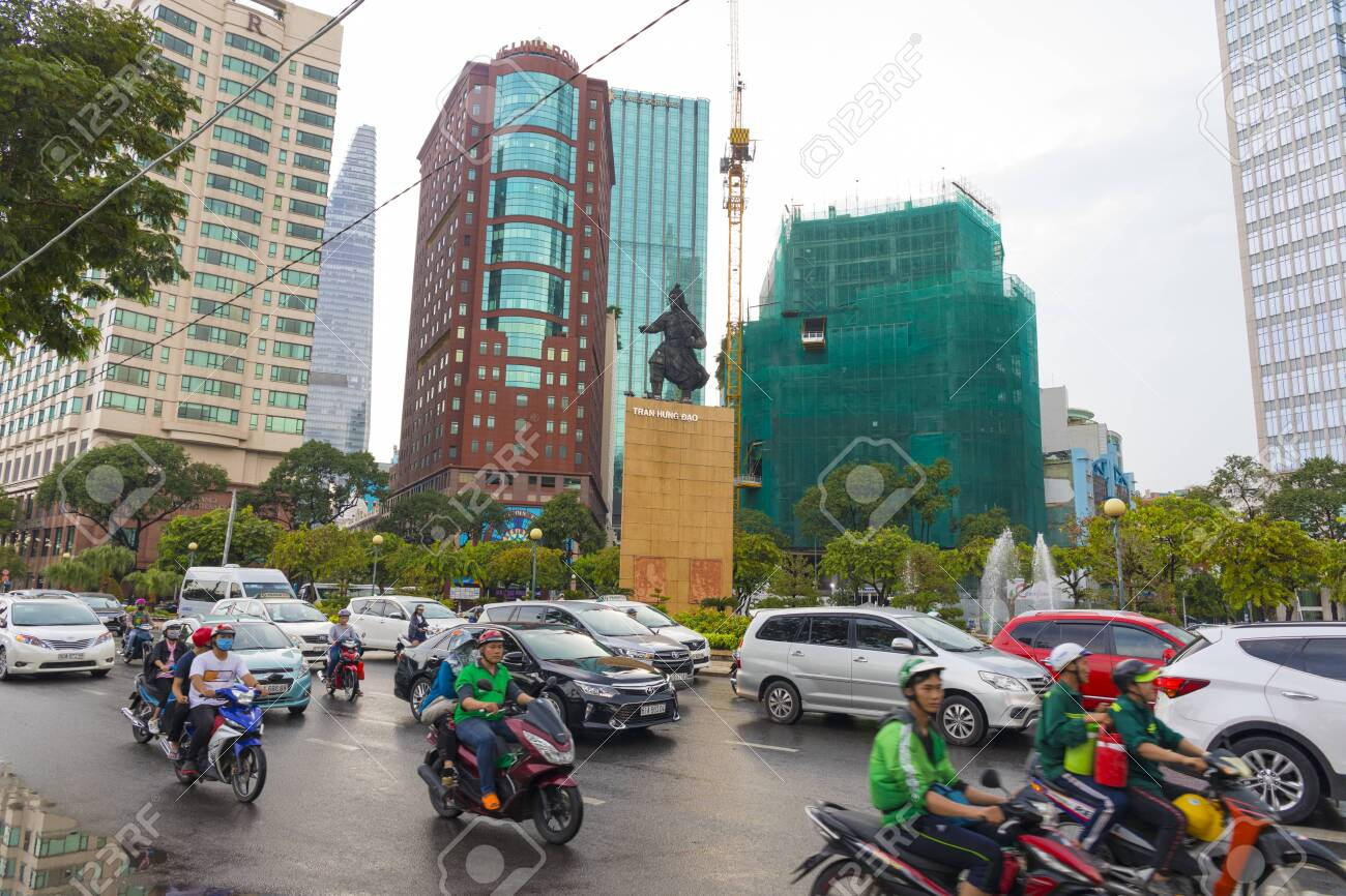 View Of Tran Hung Dao Statue With Many Cars And Bike In The Foreground Stock Photo Picture And Royalty Free Image Image 138745116