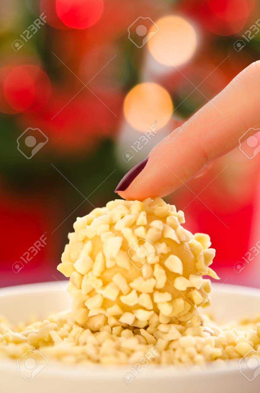 Slender female hands holding almond cookies Stock Photo - 17056305