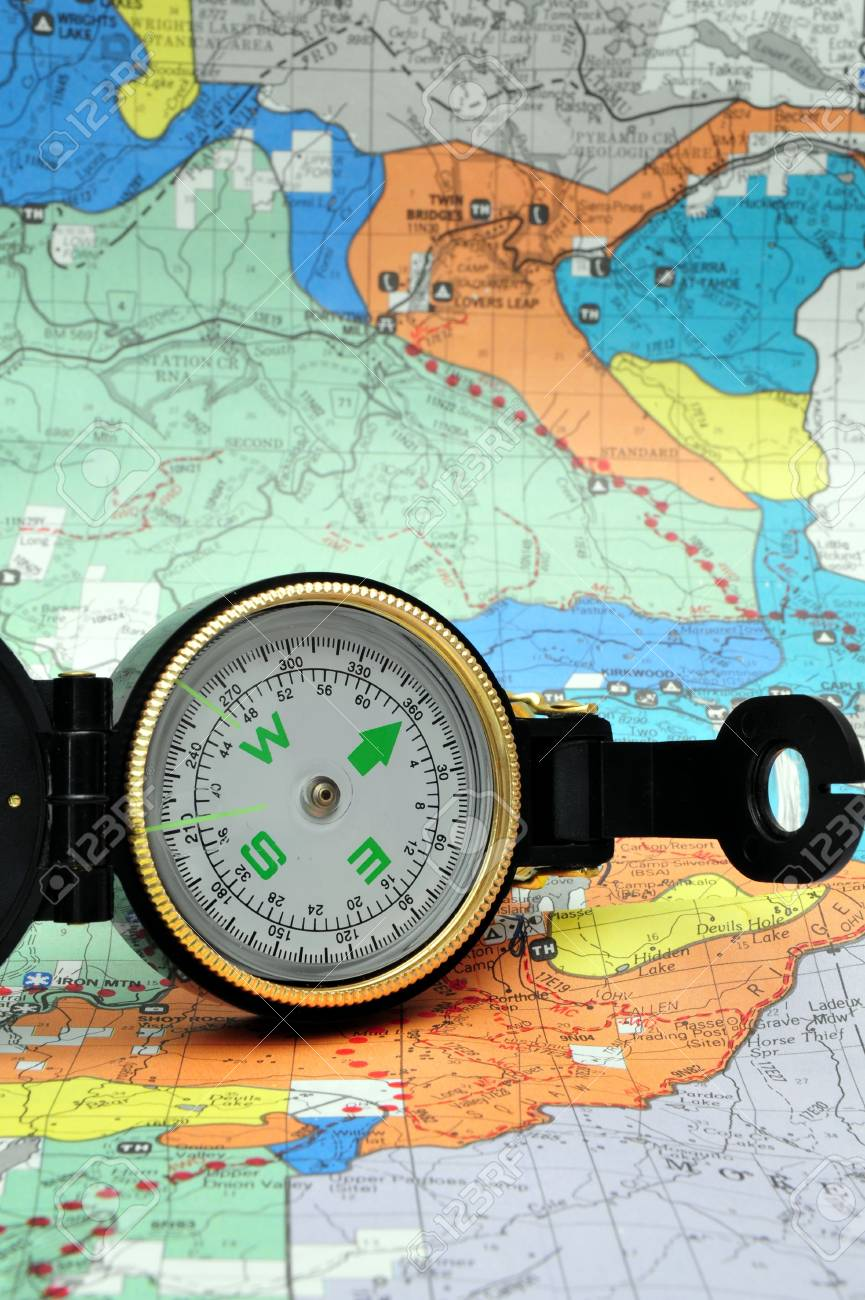 A black lensatic compass on hiking map Stock Photo - 3820998