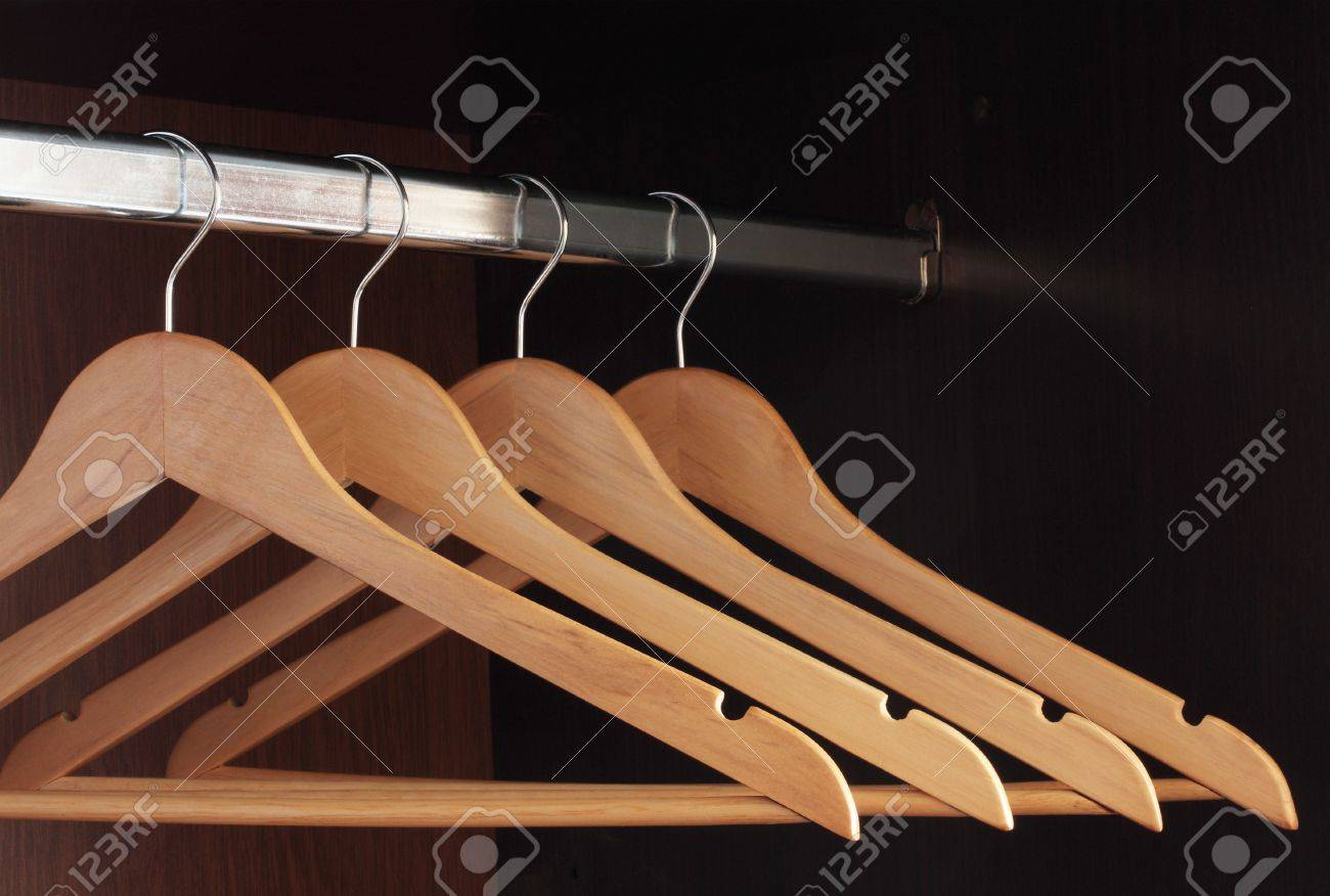 Wooden Hangers Hanging In An Empty Closet On The Upper Stock Photo 6550244