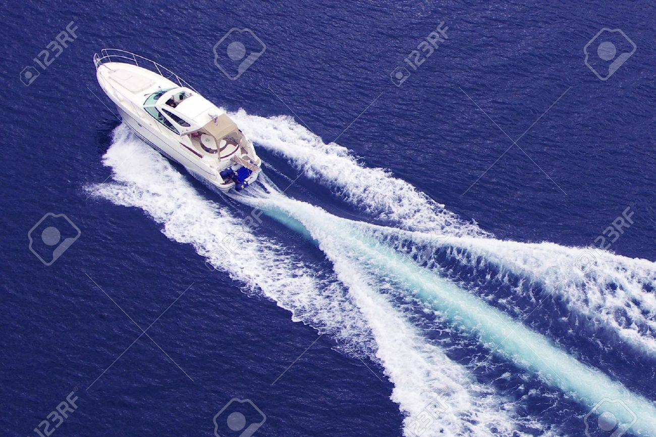 fast motor boat with splash and wake Stock Photo - 3409432