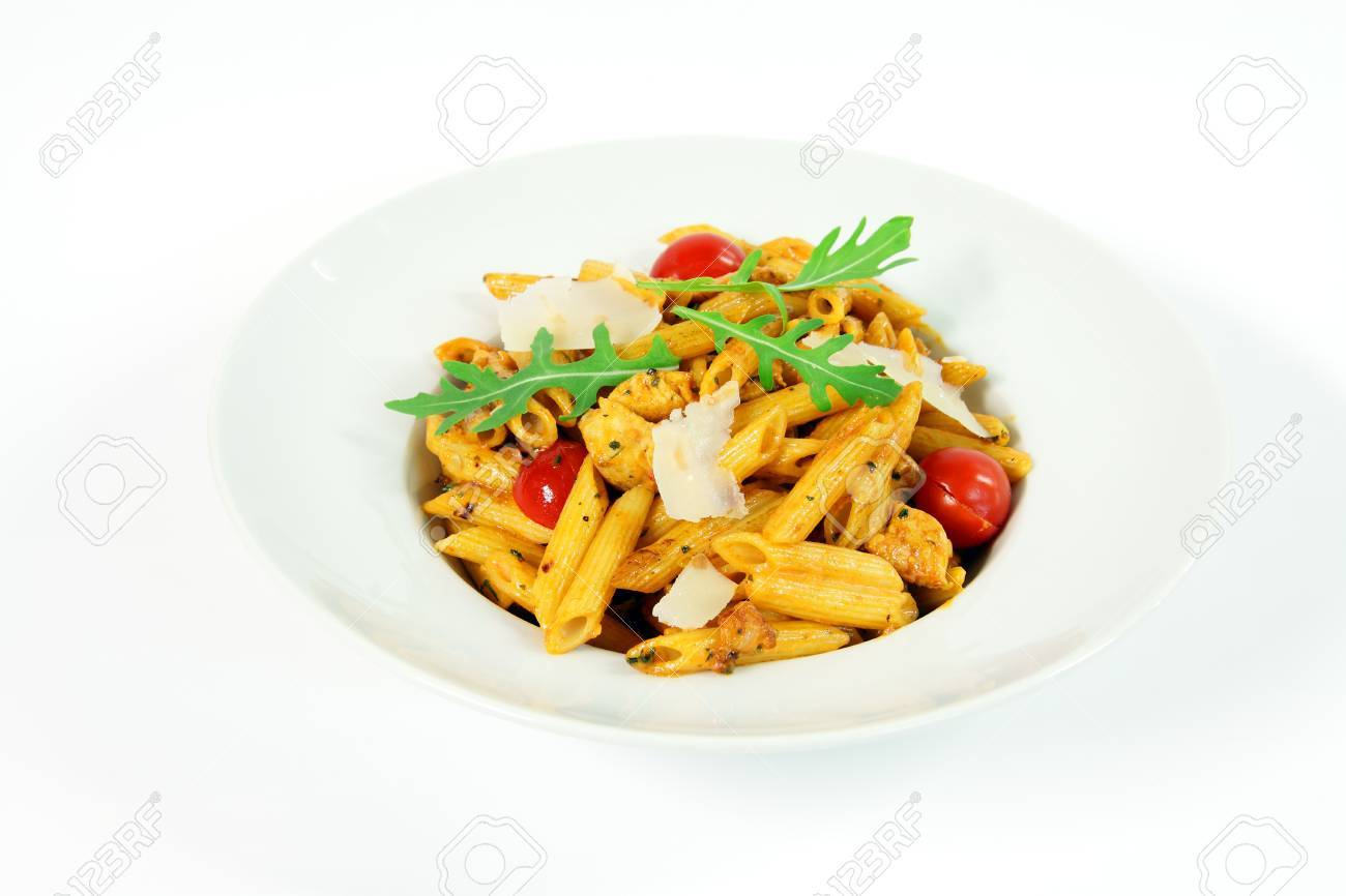 Penne alla vodka with chicken meat and salad rucola Stock Photo - 9146539