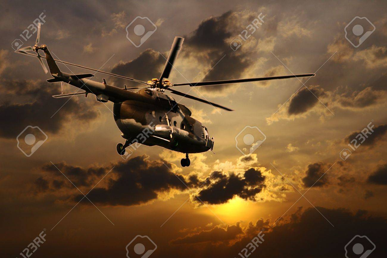Helicopter landing at sunset Stock Photo - 10522995