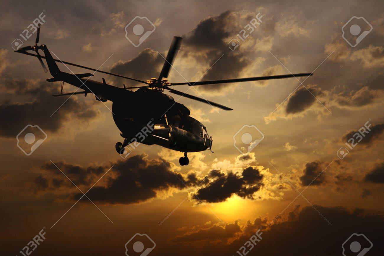 Helicopter landing at sunset Stock Photo - 10598555