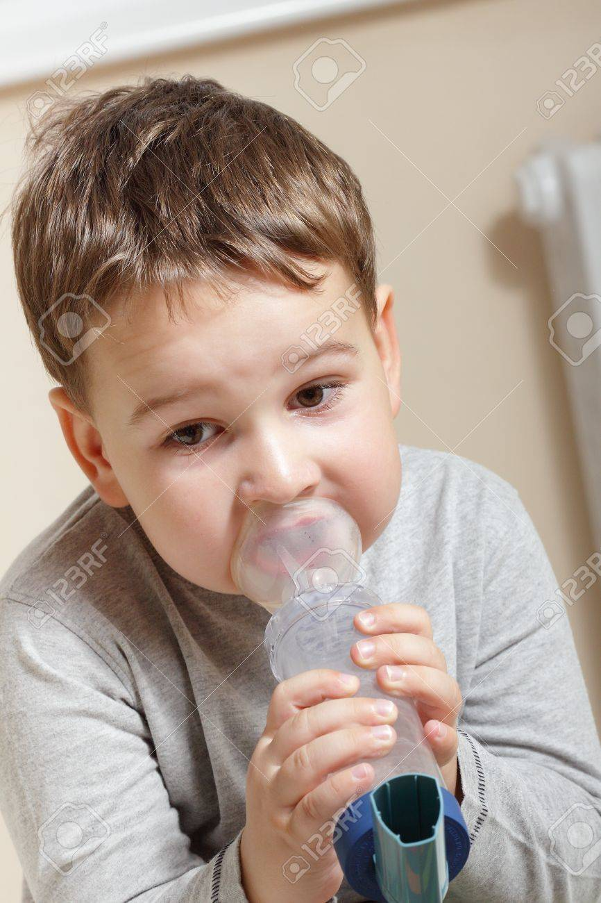 Close-up image little boy using inhaler for asthma. Stock Photo - 15637474