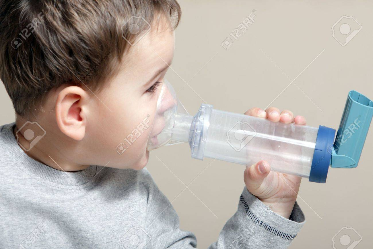 Close-up image little boy using inhaler for asthma. Stock Photo - 15637473