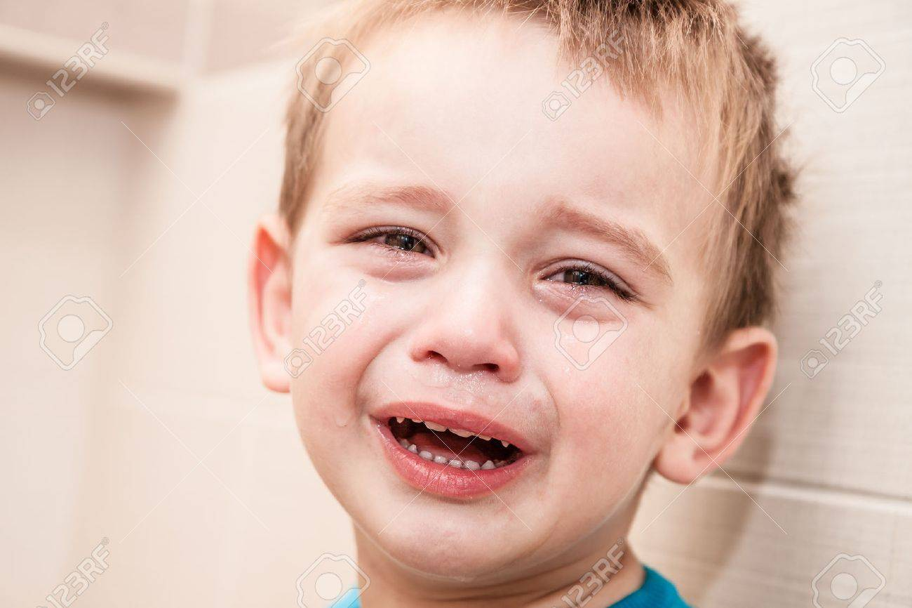 Portrait Of Crying Baby Boy In Home. Stock Photo - 25061475