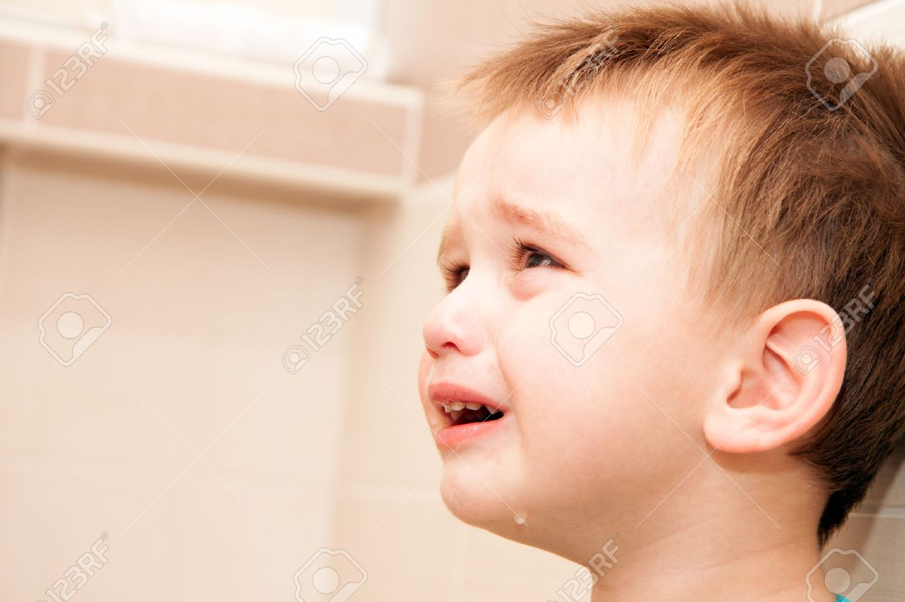 Portrait Of Crying Baby Boy In Home. Stock Photo - 25061479