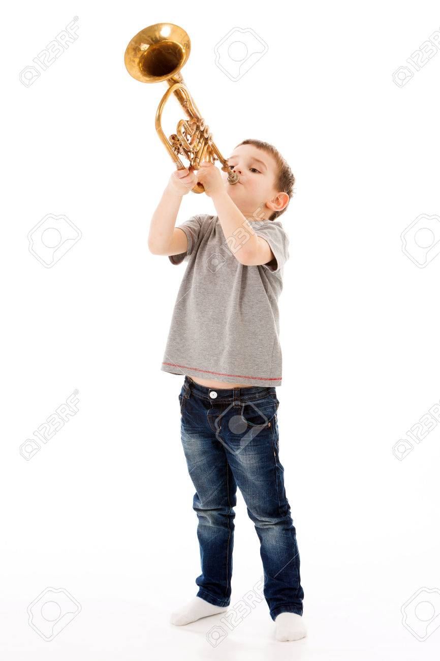 young boy blowing into a trumpet against white background Stock Photo - 56871405