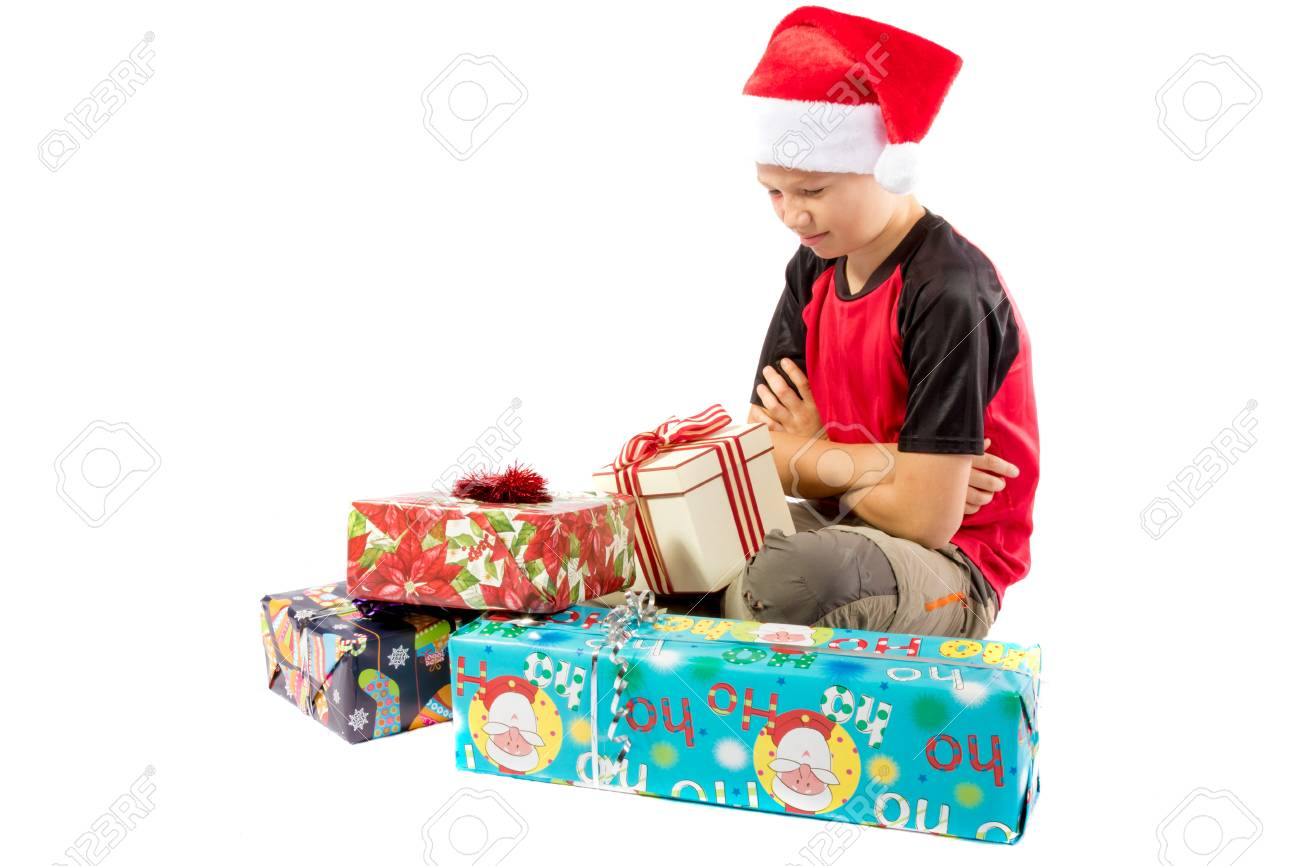 Teen Boy Christmas.Sulking Pre Teen Boy With A Pile Of Christmas Gifts