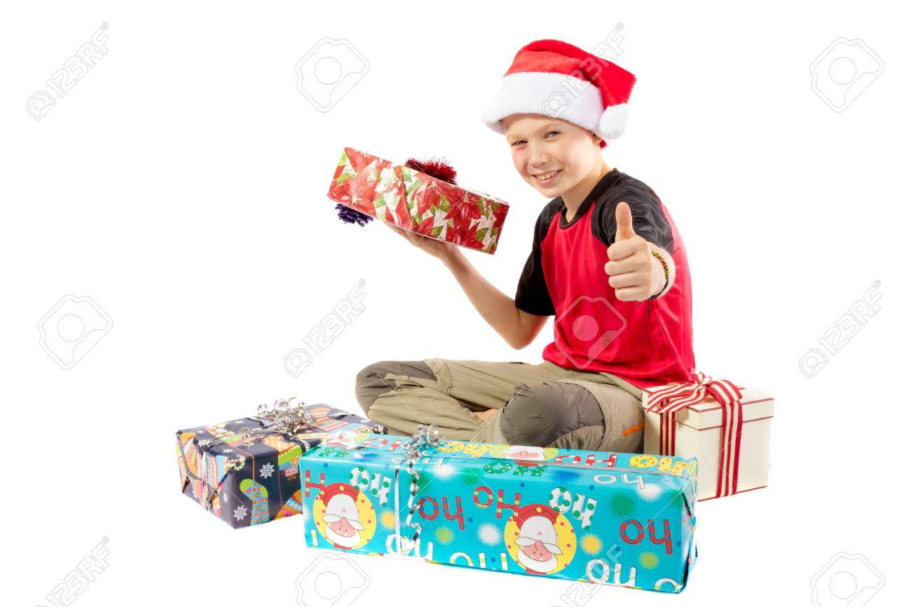 Happy Pre-teen Boy With A Pile Of Christmas Gifts Isolated On ...
