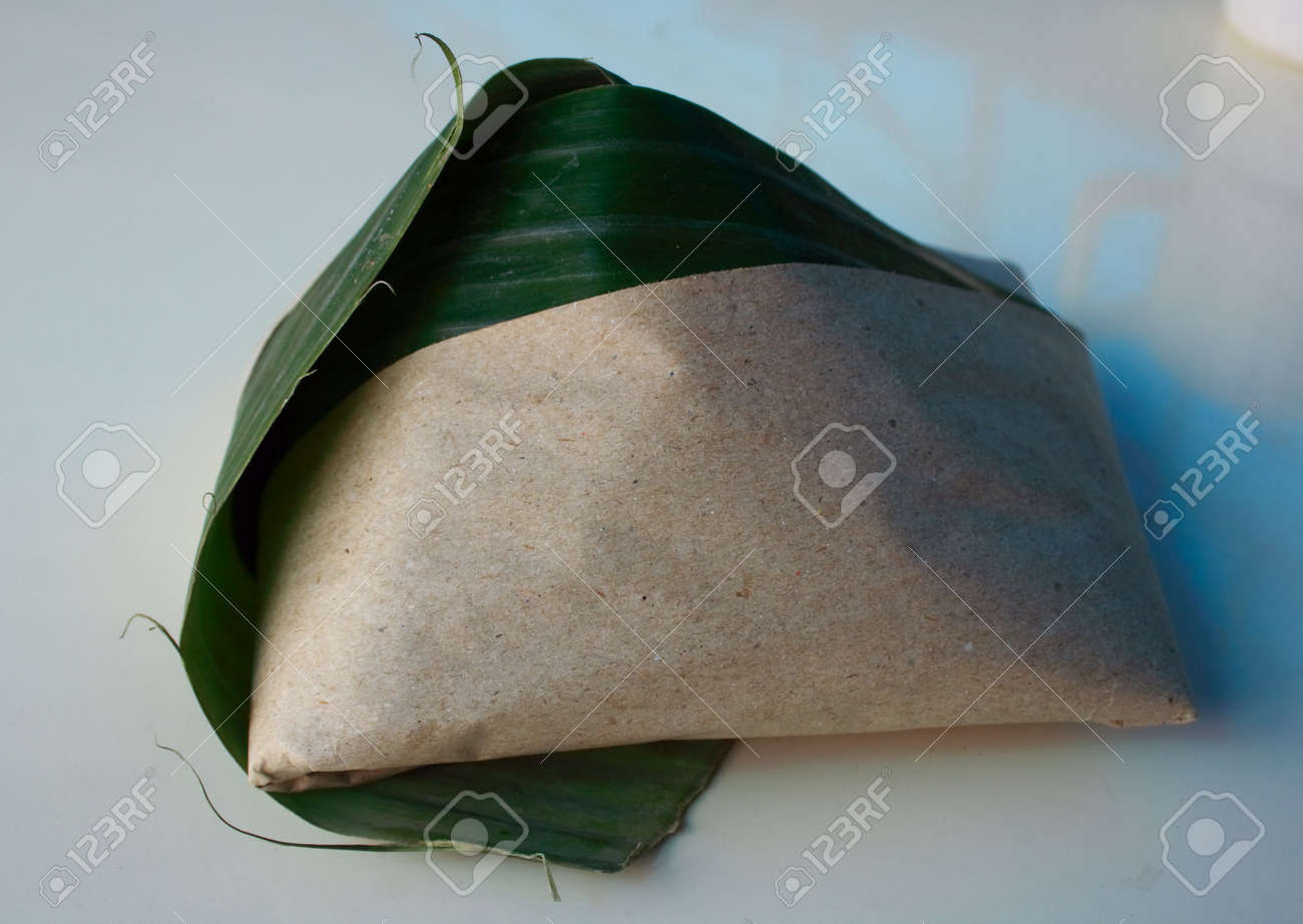 A packet of Malaysia popular food rice with coconut milk. Common breakfast in Malaysia and Singapore. Stock Photo - 2585545