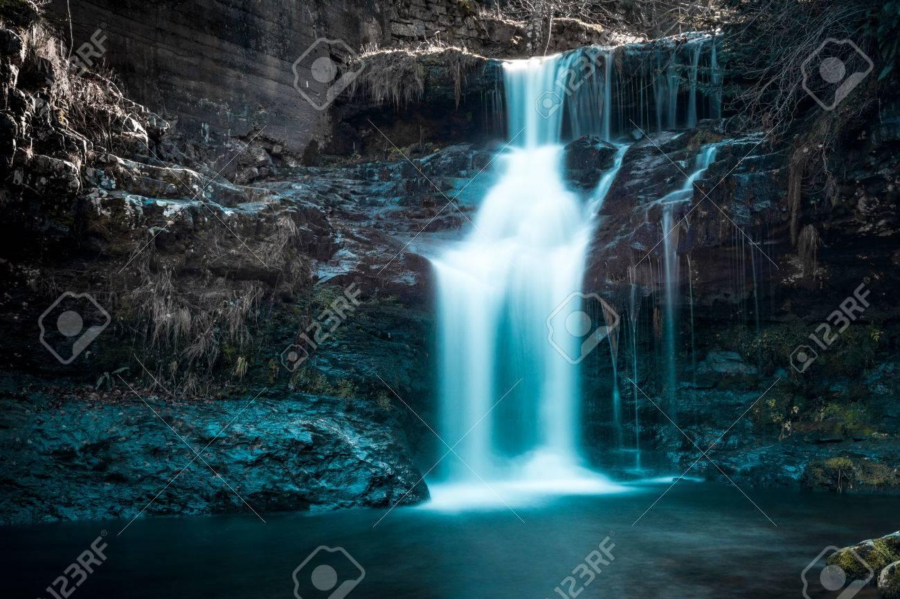 waterfall in winter - 70614204
