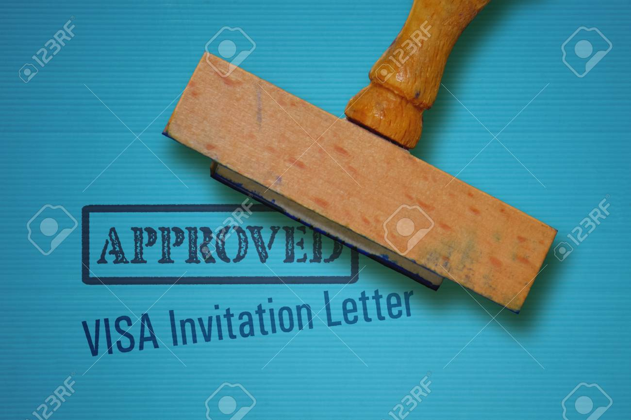 Text visa invitation letter and rubber stamp on blue background stock photo text visa invitation letter and rubber stamp on blue background stopboris Gallery