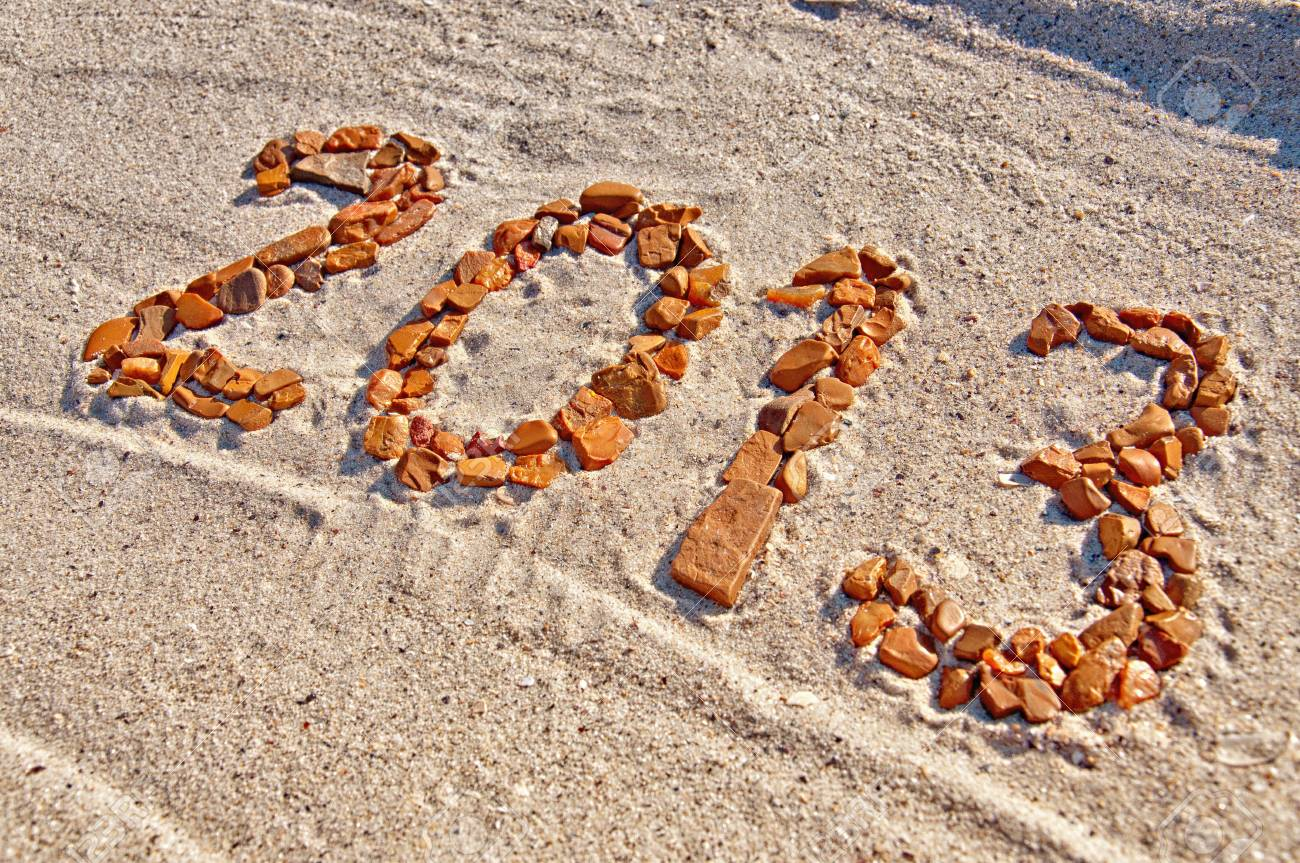2013 inscription made from pebbles lying on sand surface Stock Photo - 16819944