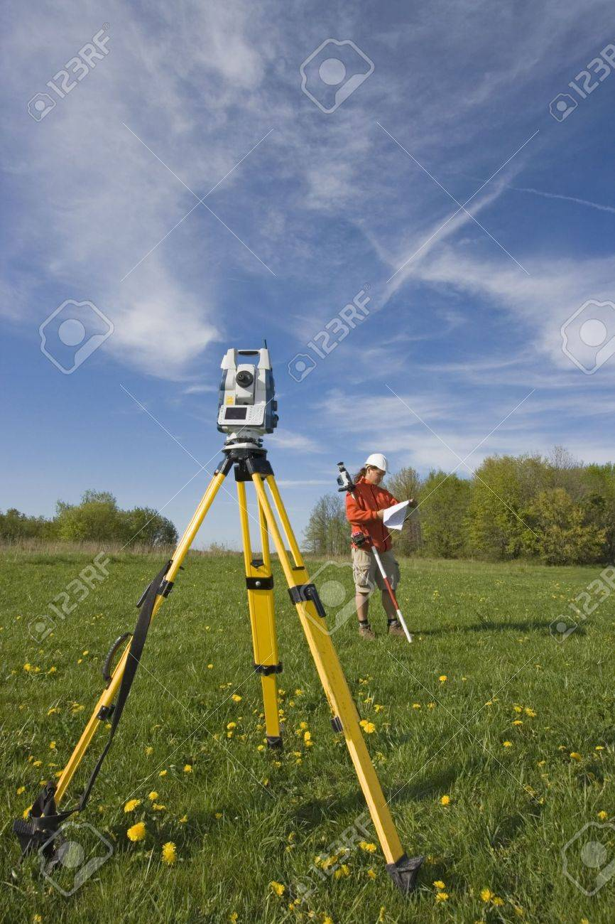 Analizing a map - spring land surveying. Stock Photo - 6151678
