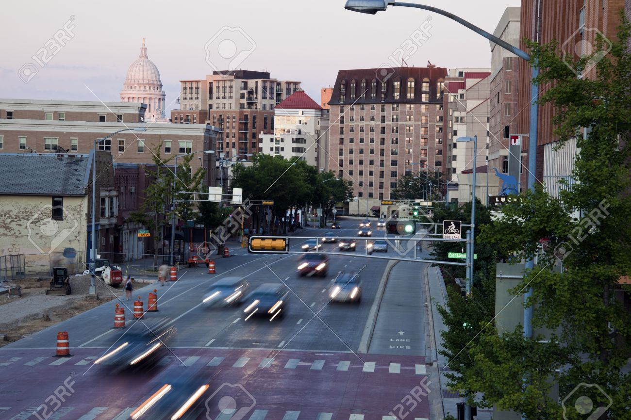 Madison, Wisconsin, USA Traffic on University Avenue in downtown of Madison. Dome of the State Capitol Building far left. August 17, 2011 Stock Photo - 10484384