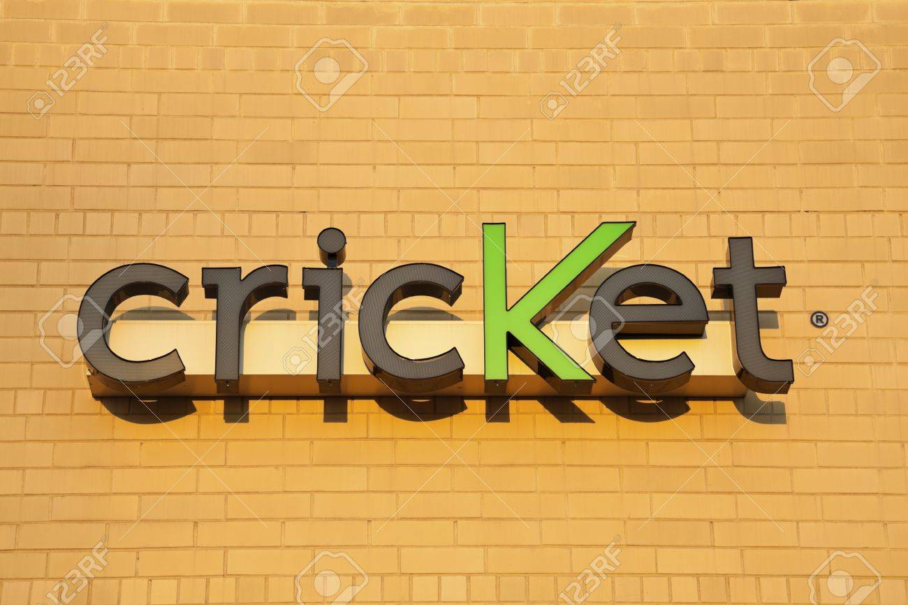 Cricket sign on the brick wall. Seen late afternoon on the new building. Cricket is a wireless company providing the services in the US. Founded in 1999. Chicago, Illinois, USA September 12, 2011 Stock Photo - 11249474