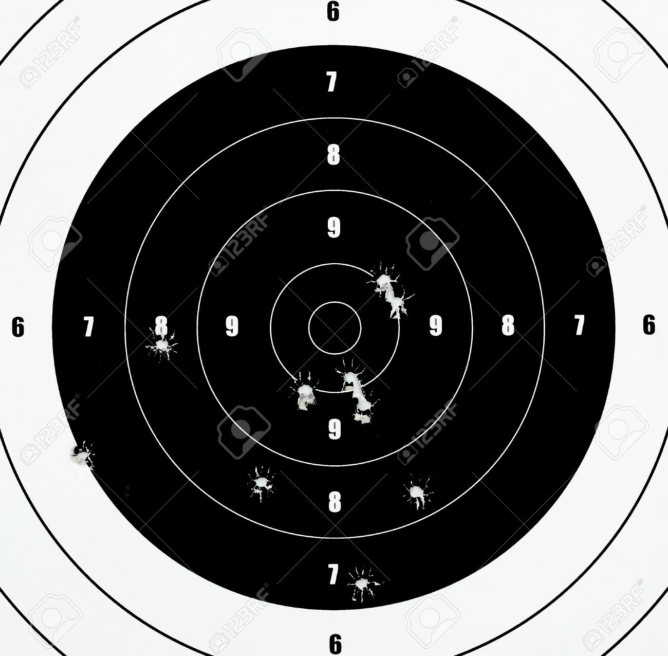 A Closeup of a practice target used for shooting with bullet holes in it. Stock Photo - 10522018