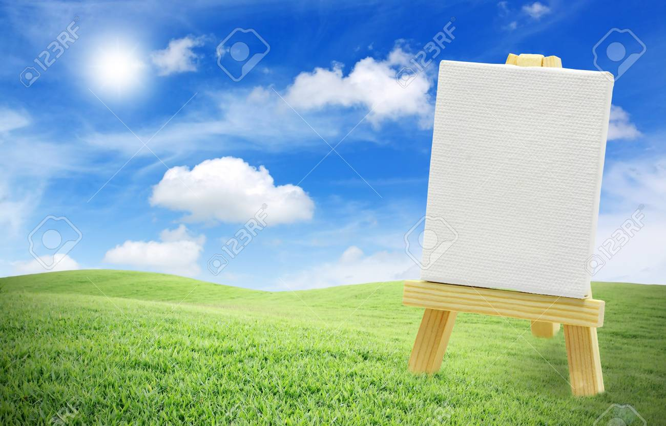 Isolated easel with empty canvas on green grass, blue sky Stock Photo - 11969689