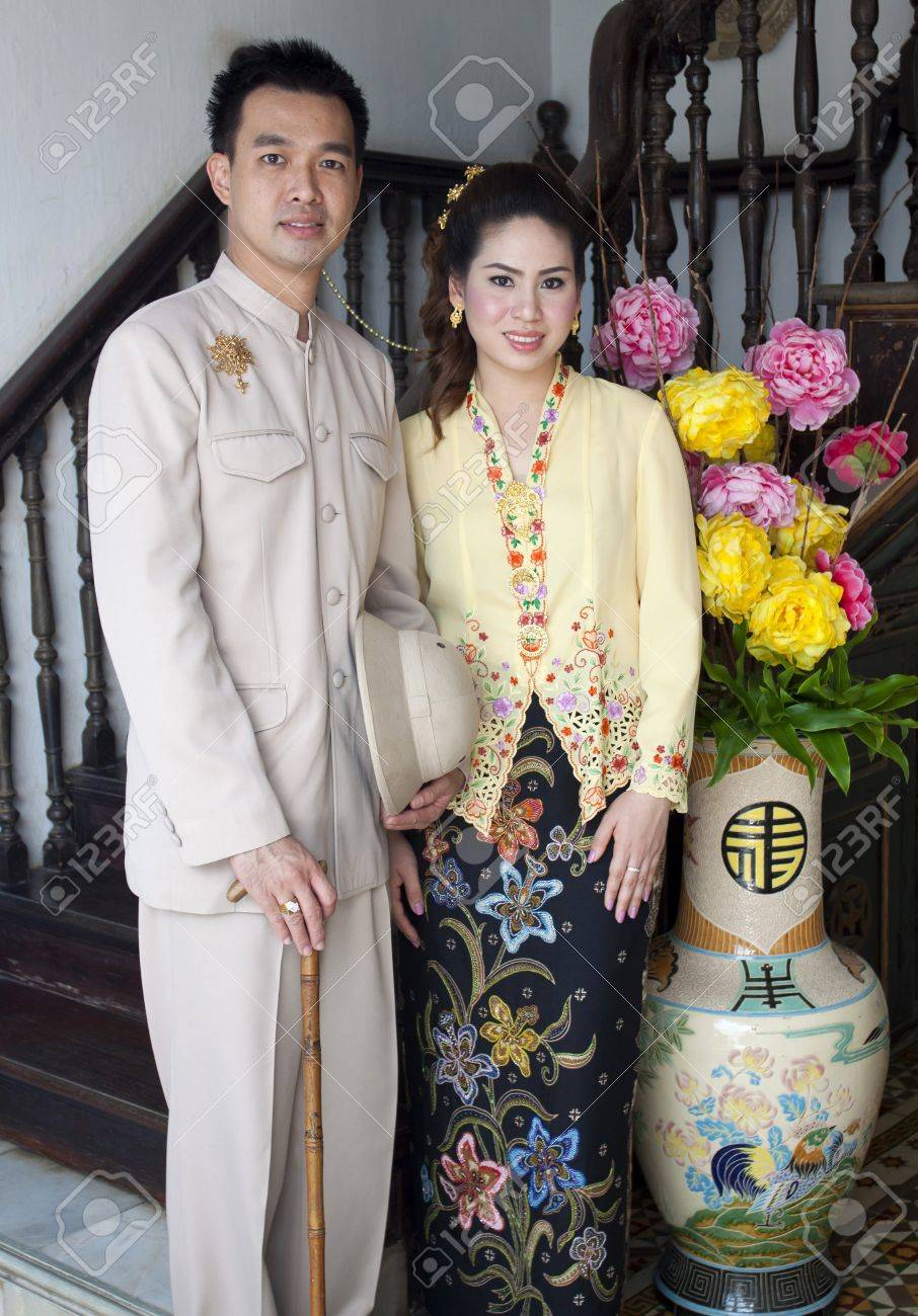 portrait of couple asian smiling with traditional clothing Peranakan dress Stock Photo - 15891696