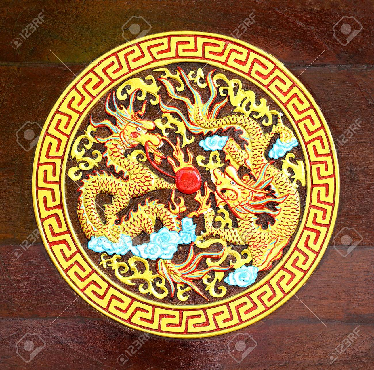 Golden Dragon carved  wood background Stock Photo - 22404079