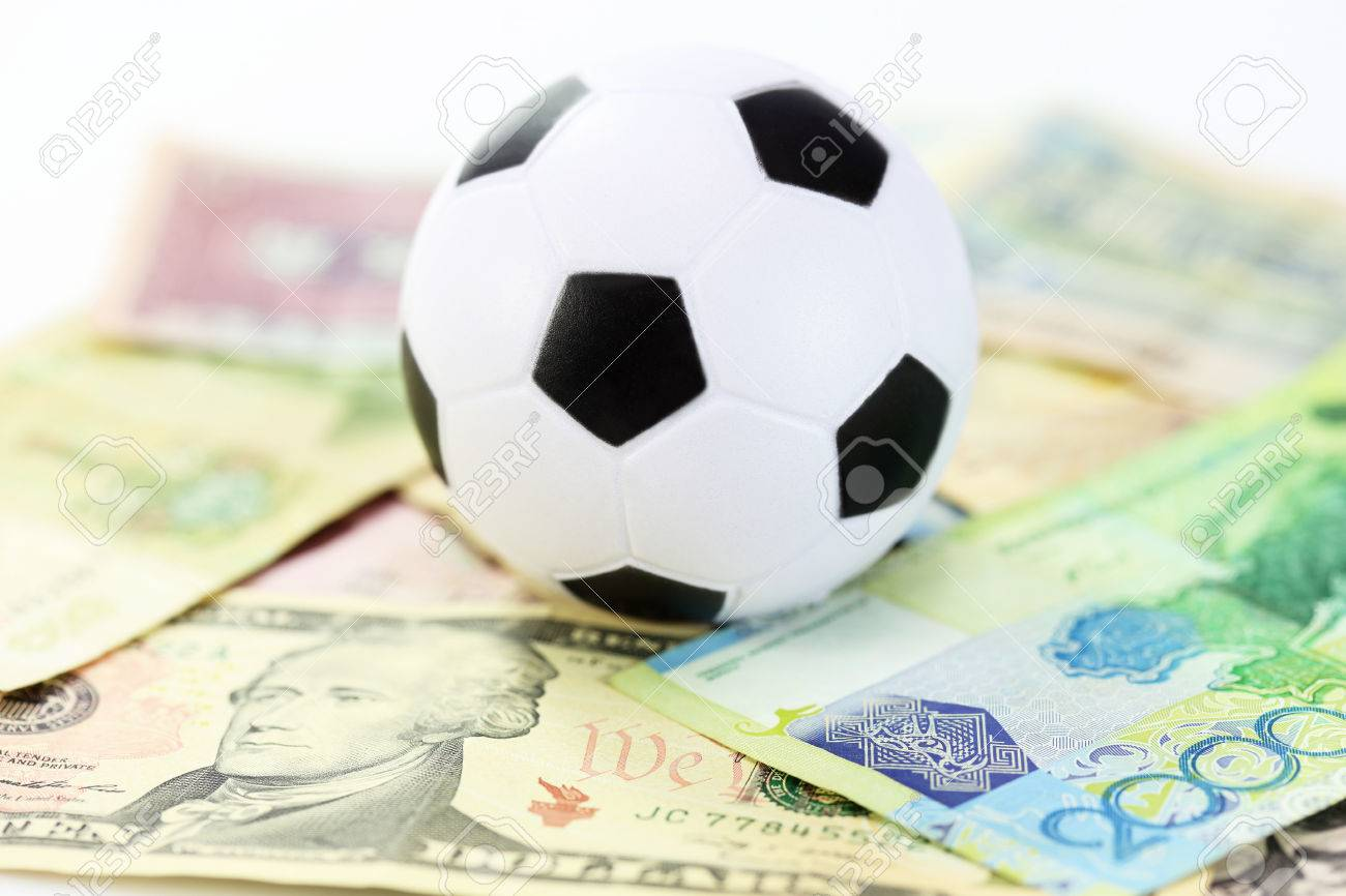 Football And Money Soccer Betting Concept Stock Photo, Picture And Royalty  Free Image. Image 28831137.