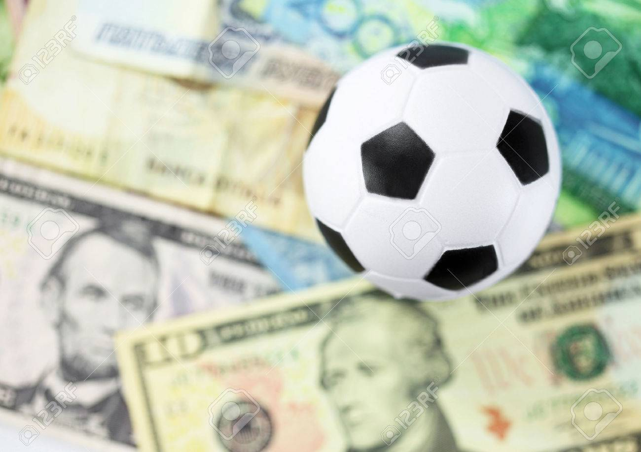 Football And Money Soccer Betting Concept Stock Photo, Picture And Royalty  Free Image. Image 28831146.