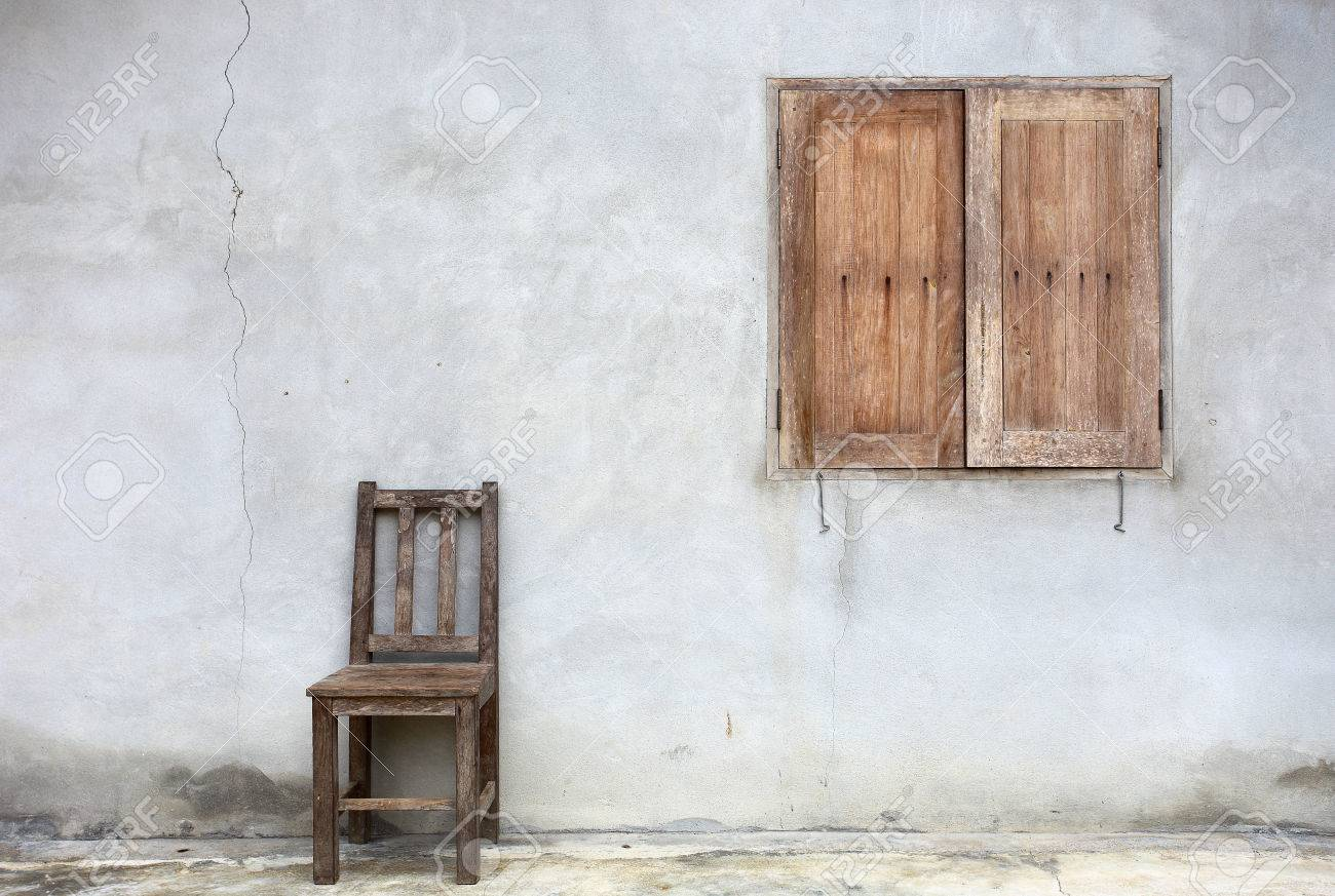 window chair furniture. Old Chair Against Wall With Window Background Stock Photo - 44170408 Furniture X