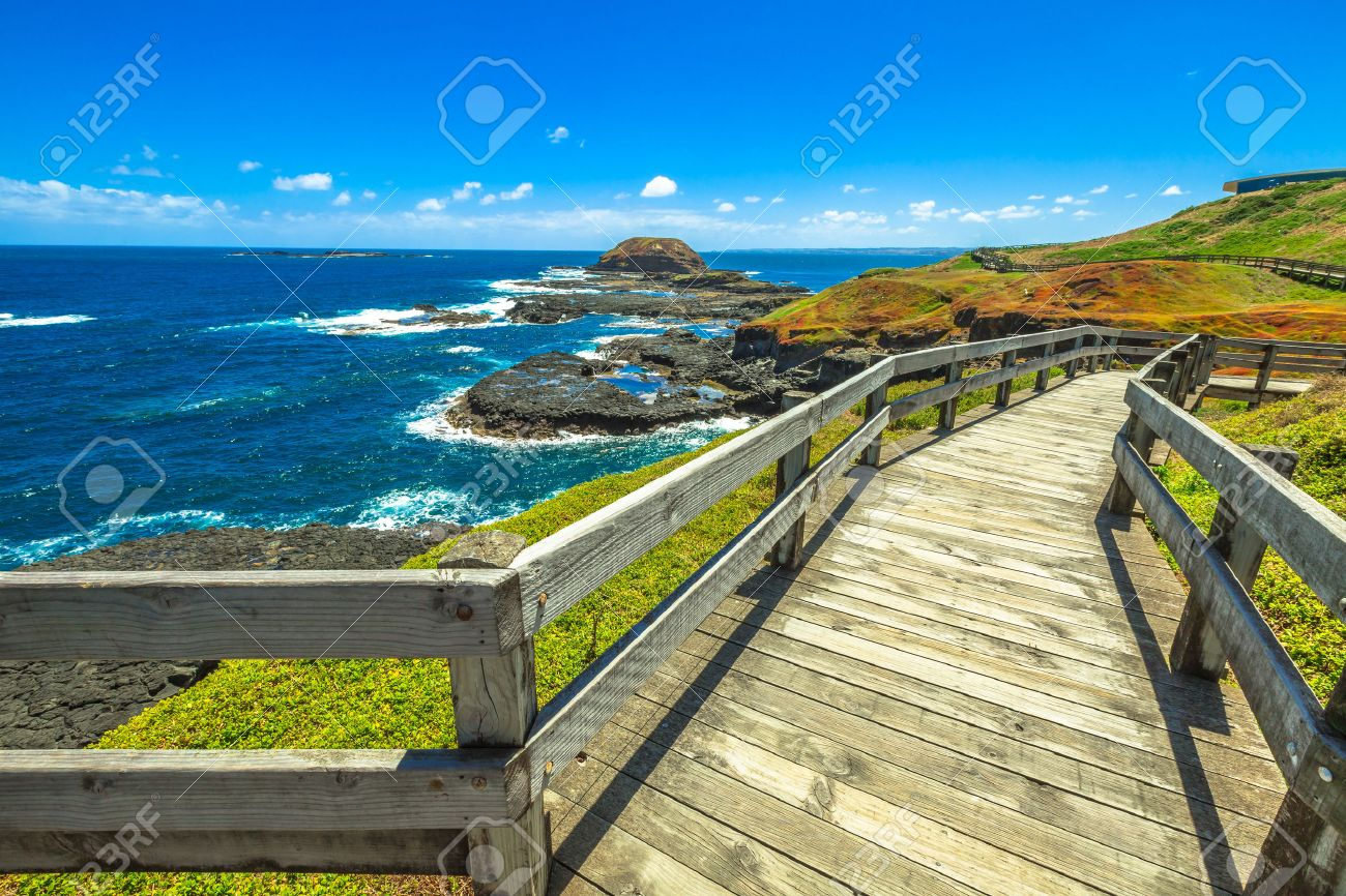 The boardwalks outside The Nobbies center overlook Seal Rocks. Grant Point, western tip of Phillip Island, Victoria, Australia. - 42025005