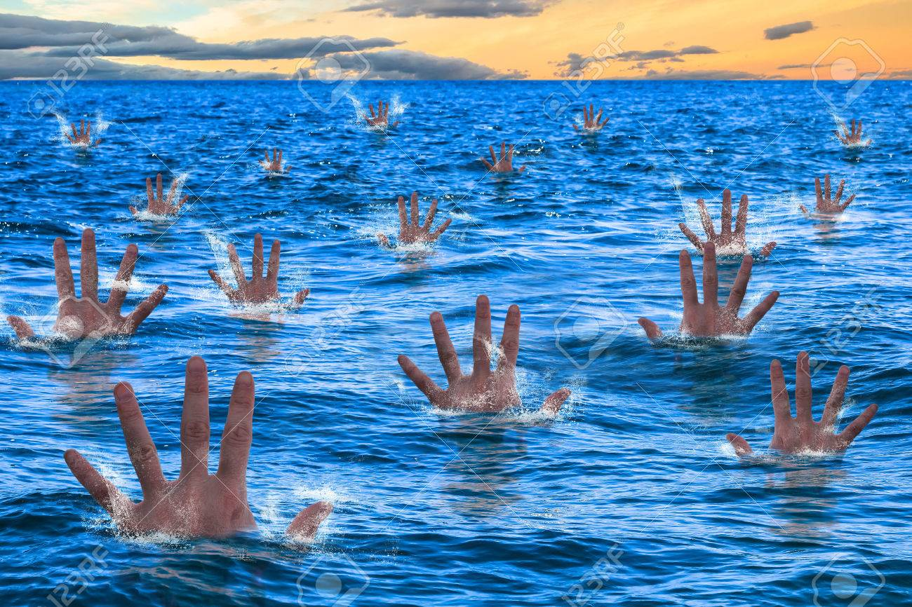 Hands of a men sinking and drowning in the sea. Business concept failed, bugdet not reached, bankruptcy risk company, concept drowning, bankruptcy, financial emergency. Stock Photo - 42060698