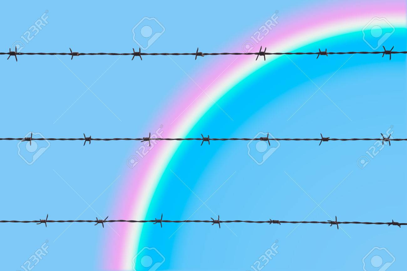 A Rainbow Against The Blue Sky Beyond A Barbed Wire, Symbolizes ...